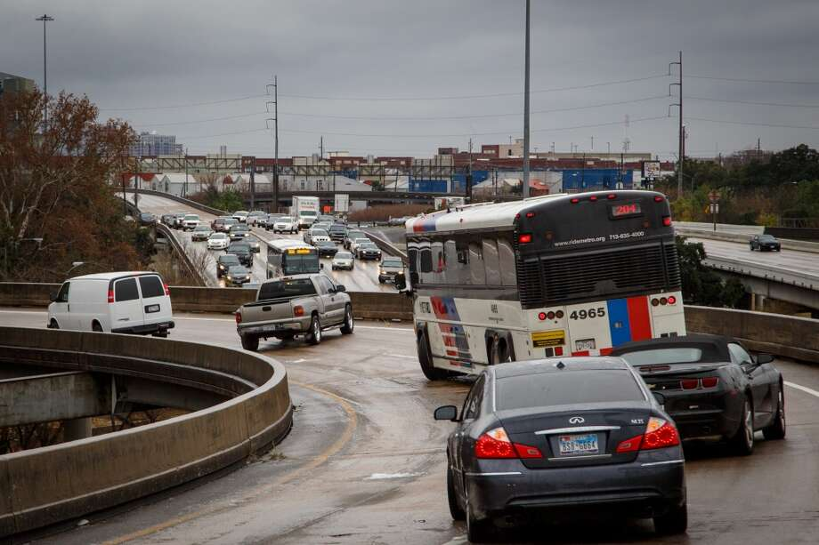 Vehicles wait for help after becoming stranded on the McKinney St. exit ramp off of I-45 due to icy road conditions, Friday, Jan. 24, 2014, in Houston. ( Michael Paulsen / Houston Chronicle ) Photo: Michael Paulsen, Houston Chronicle