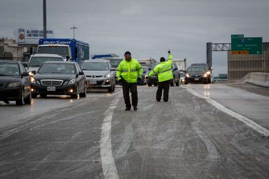 Mobility Response Team members direct traffic along I-45 near Downtown after icy road conditions snarled traffic, Friday, Jan. 24, 2014, in Houston. ( Michael Paulsen / Houston Chronicle ) Photo: Michael Paulsen, Houston Chronicle