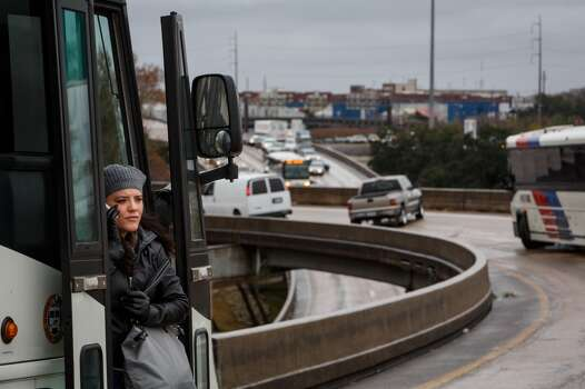 Debora Walker looks outside from a Metro Bus while making a phone call to her boyfriend to pick her up after becoming stranded for over 2hrs. on the McKinney St. exit ramp off of I-45 due to icy road conditions that snarled the morning commute, Friday, Jan. 24, 2014, in Houston. ( Michael Paulsen / Houston Chronicle ) Photo: Michael Paulsen, Houston Chronicle