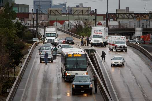 Motorists are stopped along I-45 northbound near Pierce Elevated due to icy road conditions that snarled the morning commute, Friday, Jan. 24, 2014, in Houston. ( Michael Paulsen / Houston Chronicle ) Photo: Michael Paulsen, Houston Chronicle