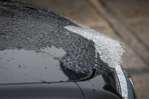 An ice sheet slides down a car traveling on I-45 where icy road conditions snarled the morning commute, Friday, Jan. 24, 2014, in Houston. ( Michael Paulsen / Houston Chronicle ) Photo: Michael Paulsen, Houston Chronicle