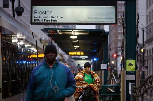 Pedestrians exit the MetroRail where icy cold road conditions snarled the morning commute, Friday, Jan. 24, 2014, in Houston. ( Michael Paulsen / Houston Chronicle ) Photo: Michael Paulsen, Houston Chronicle