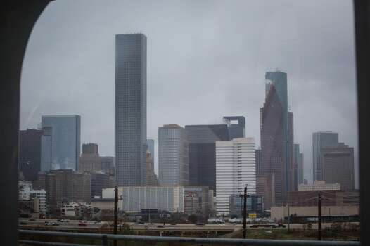 The downtown Houston skyline where icy cold road conditions snarled the morning commute, Friday, Jan. 24, 2014, in Houston. ( Michael Paulsen / Houston Chronicle ) Photo: Michael Paulsen, Houston Chronicle