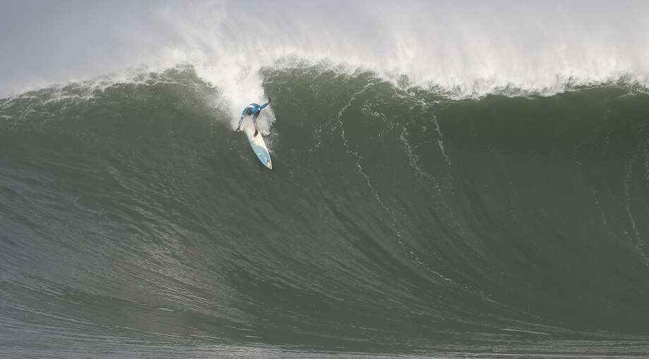 Peter Mel, last year's champion, takes off on a set wave during first round of the Maverick's Invitational surf contest in Half Moon Bay, Calif., on Friday, Jan. 24, 2014. Photo: Mathew Sumner, Special To The Chronicle