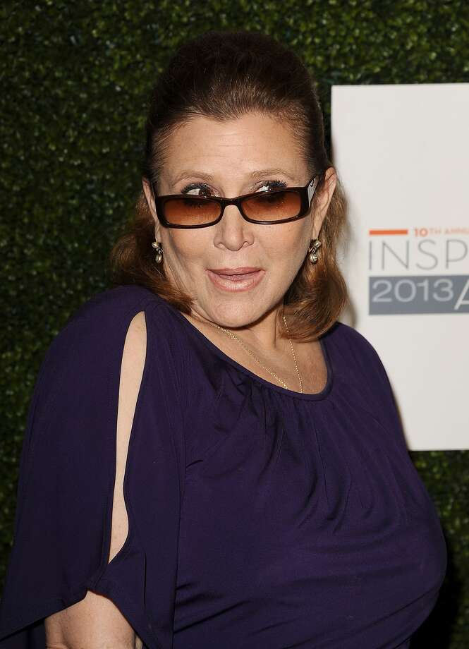 Carrie Fisher, best known as Prince Leia from 'Star Wars' (gold bikini, anyone?), is back in the news.  The actress, pictured here in Beverly Hills on May 31, 2013, announced that she will begin filming 'Star Wars: Episode VII' in March or April of this year.Se what else Fisher and the rest of the 'Star Wars' actors and characters have been up to.
