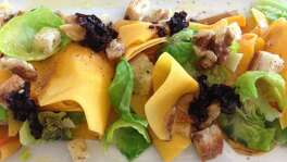 Pickled butternut squash salad with Brussels sprouts leaves, walnuts, croutons and pickled shallot at Coltivare.