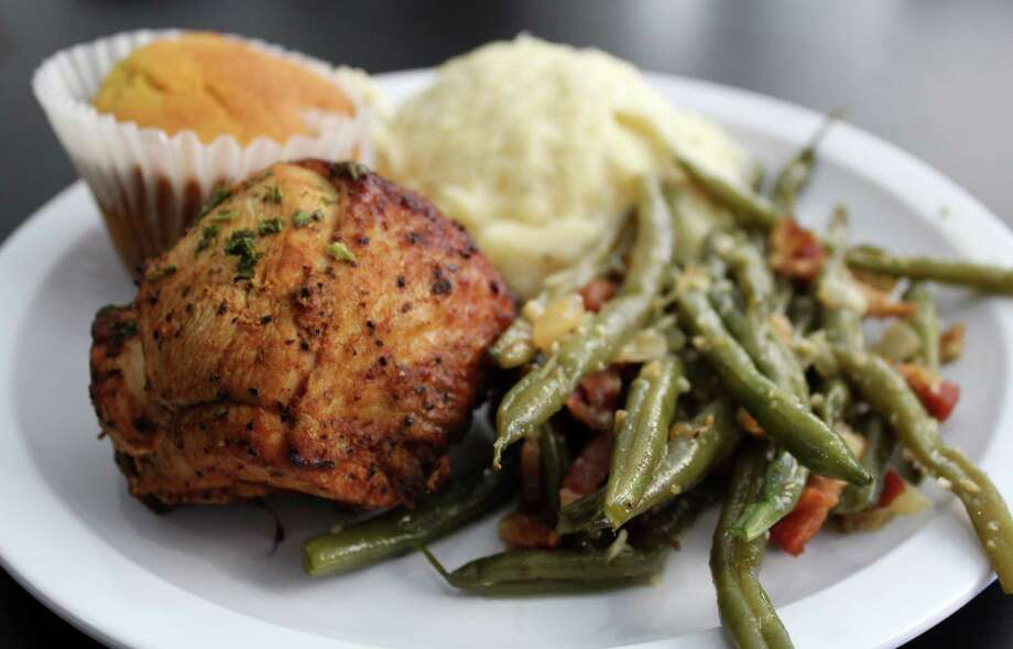 Kajun Kuisine serves cafeteria-style soul food, including baked chicken with green beans and mashed potatoes.  Photo: Jennifer McInnis
