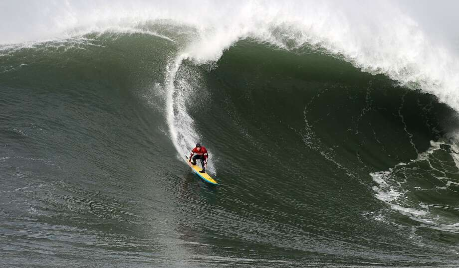 Colin Dwyer takes off on a wave during first round of the Maverick's Invitational surf contest in Half Moon Bay, Calif., on Friday, Jan. 24, 2014. Photo: Mathew Sumner, Special To The Chronicle