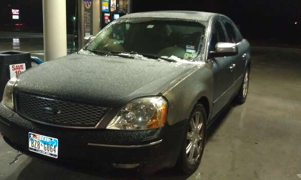 An icy car gets filled with gas in Northwest Houston on Friday. (Submitted by Michelle Morrow)