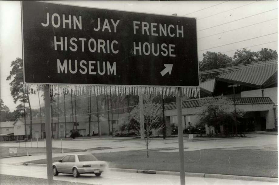 John Jay French sign in northbound lane of Eastex Freeway near junction with Interstate 10.