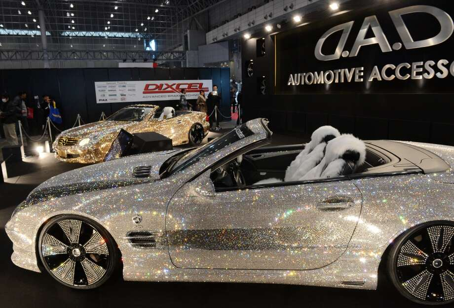 Swalovski-crystal-covered Mercedes-Benz convertibles are displayed during the Tokyo Auto Salon exhibition at the Makuhari Messe in Chiba. Photo: TOSHIFUMI KITAMURA, AFP/Getty Images