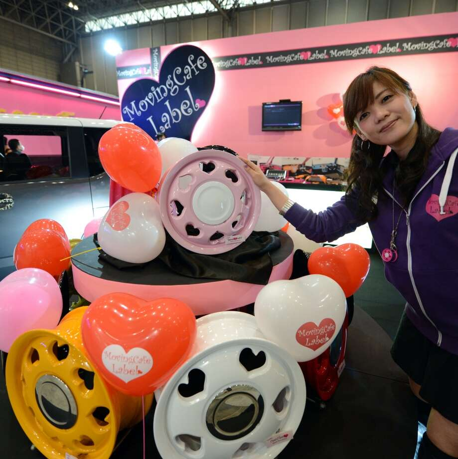A model shows off G-corporation's customized wheels during the Tokyo Auto Salon 2013 exhibition at the Makuhari Messe in Chiba. Photo: TOSHIFUMI KITAMURA, AFP/Getty Images