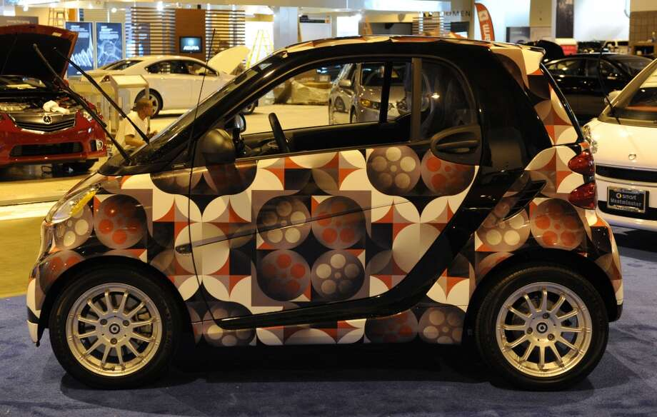 "The Passion Smart Car that has been ""wrapped"" at the Denver Auto Show. Photo: Kathryn Scott Osler, Denver Post Via Getty Images"