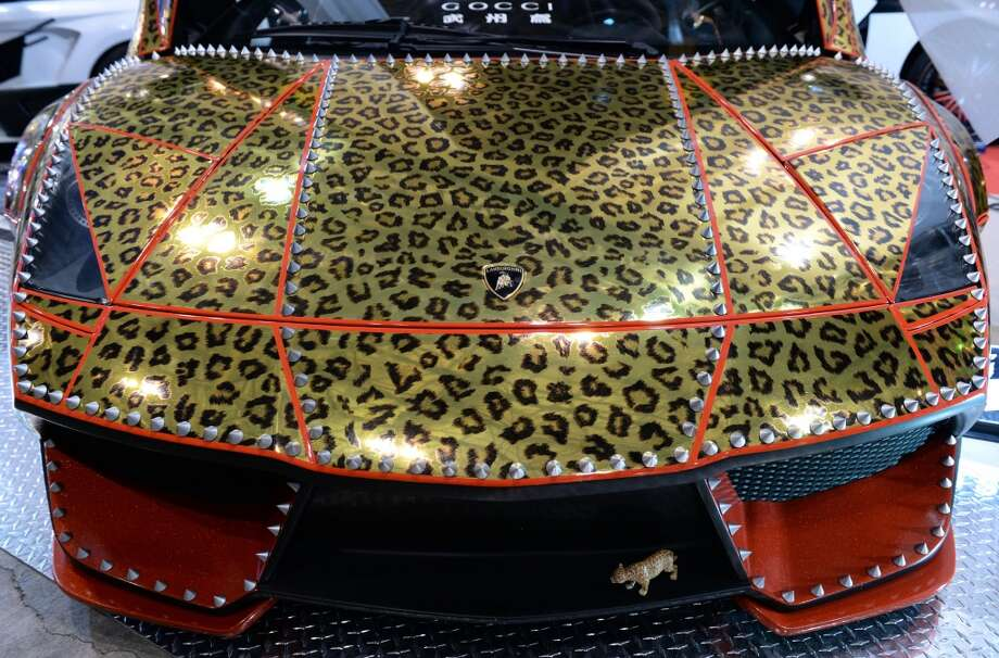An animal-pattern-designed Lamborghini Murcielago is displayed during the Tokyo Auto Salon 2014 exhibition at the Makuhari Messe in Chiba. Photo: TOSHIFUMI KITAMURA, AFP/Getty Images