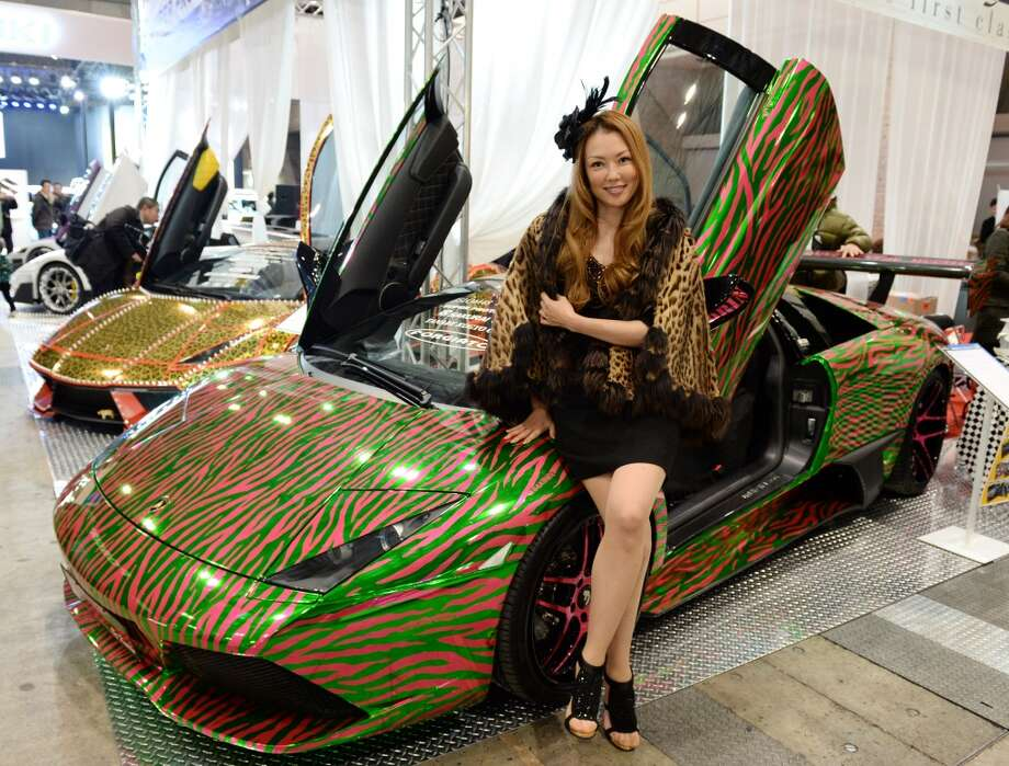 "Female Lamborghini owners group ""Koakuma"" leader DJ Kaorin sits on her animal-pattern-designed Lamborghini Murcielago during the Tokyo Auto Salon 2014 exhibition at the Makuhari Messe in Chiba. Photo: TOSHIFUMI KITAMURA, AFP/Getty Images"