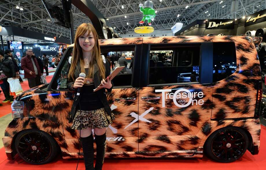 An animal-pattern-designed Honda N-box custom is displayed at the Treasure One booth during the Tokyo Auto Salon 2014 exhibition at the Makuhari Messe in Chiba. Photo: TOSHIFUMI KITAMURA, AFP/Getty Images