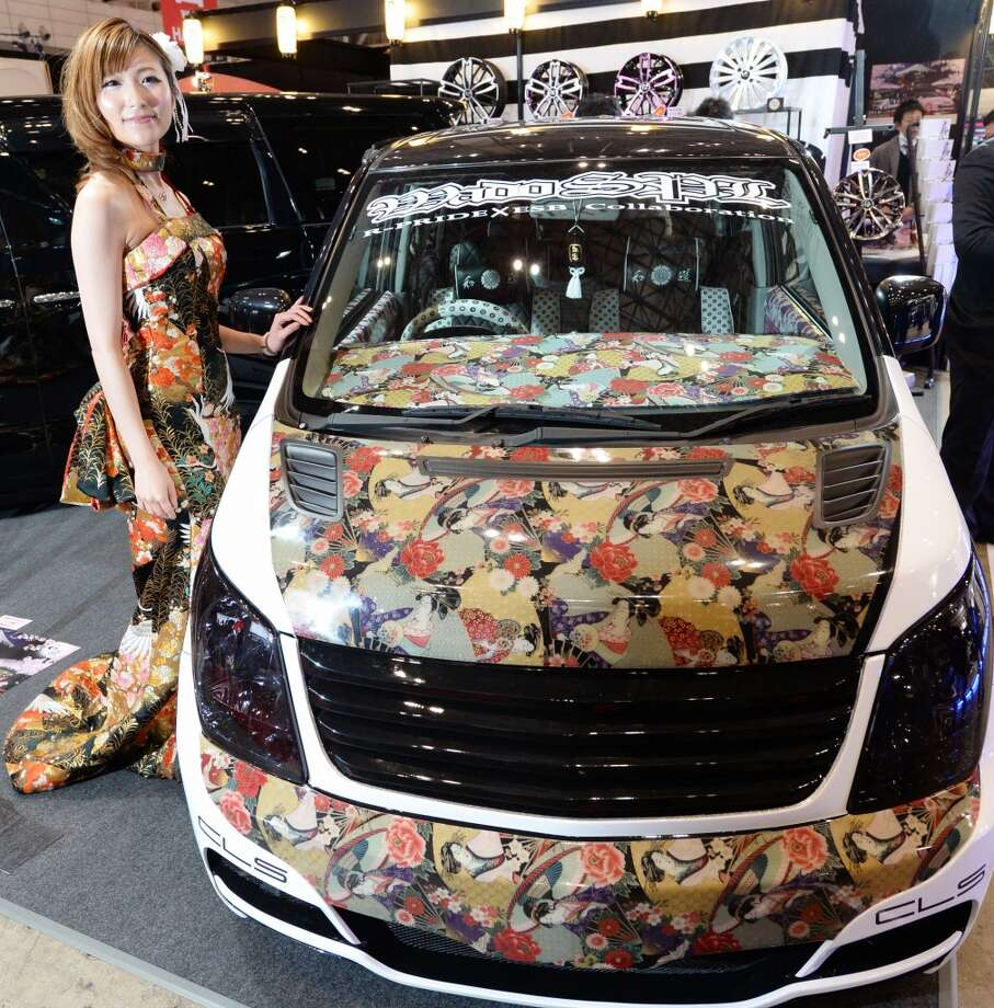 "Designed from ""Japanese-modern,"" the ""Yamato Special"" car based on Suzuki Wagon R is displayed at the Wado booth during the Tokyo Auto Salon 2014 exhibition at the Makuhari Messe in Chiba. Photo: TOSHIFUMI KITAMURA, AFP/Getty Images"