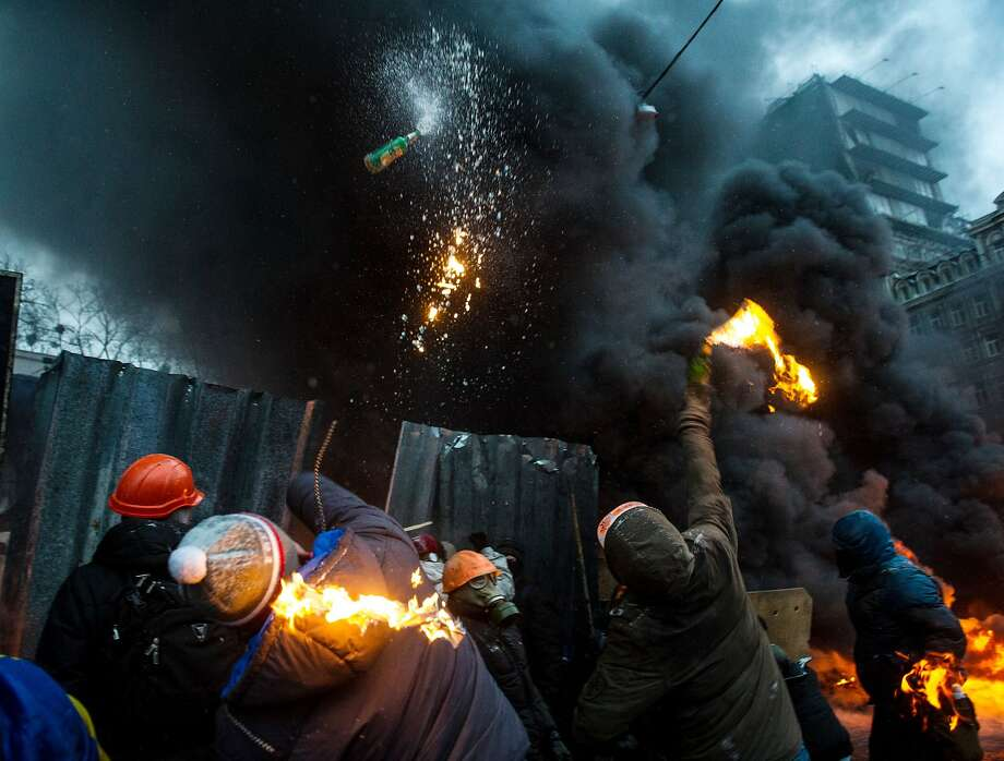 Cocktail hour:Protesters throw Molotov cocktails at police during clashes in the center of Kiev. Security