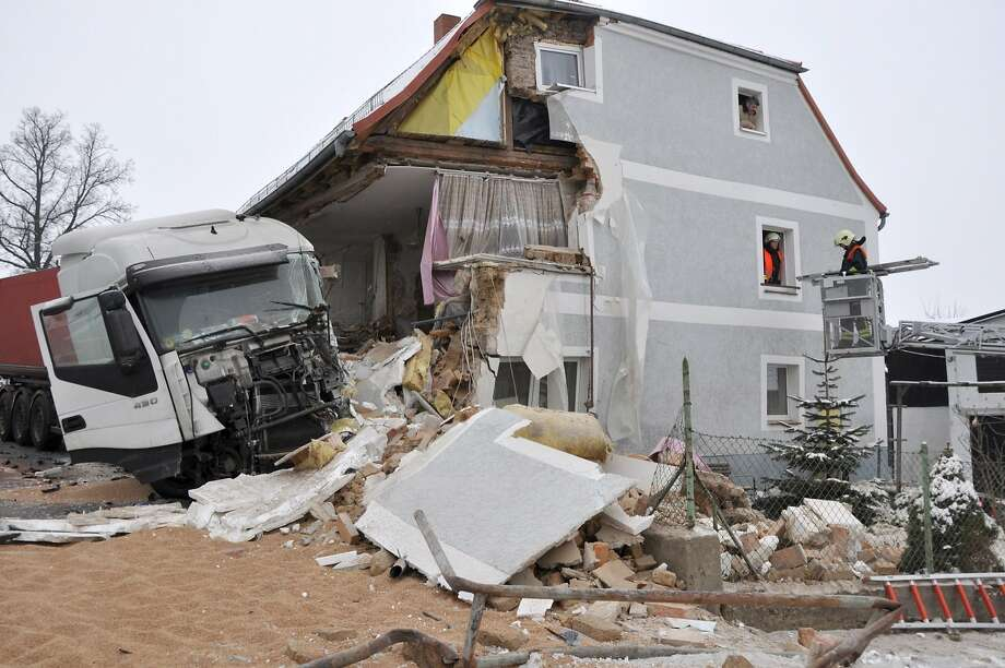 Home wrecker: Firemen inspect a damaged house after an out-of-control truck skidded on icy road and crashed into the building in Ostritz, Germany. Officials said the damage is so extensive the house may collapse. Photo: Danilo Dittrich, AFP/Getty Images