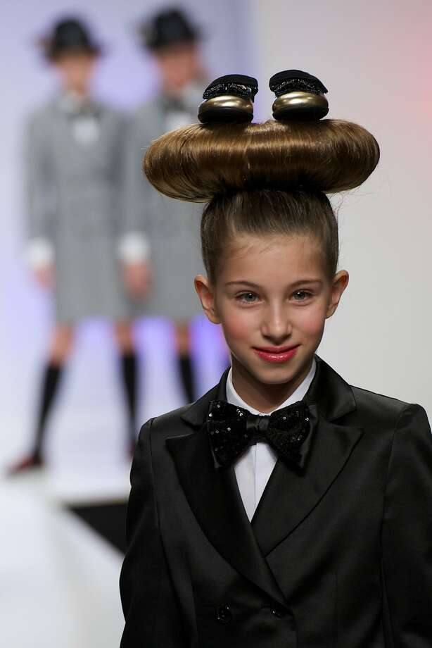 An oversized bun makes an elegant statement at the FIMI Kids International Fashion Show 2014 in Madrid. Plus, it's a great place to store an extra pair of shoes. At least we think those are shoes. Photo: Carlos Alvarez, Getty Images