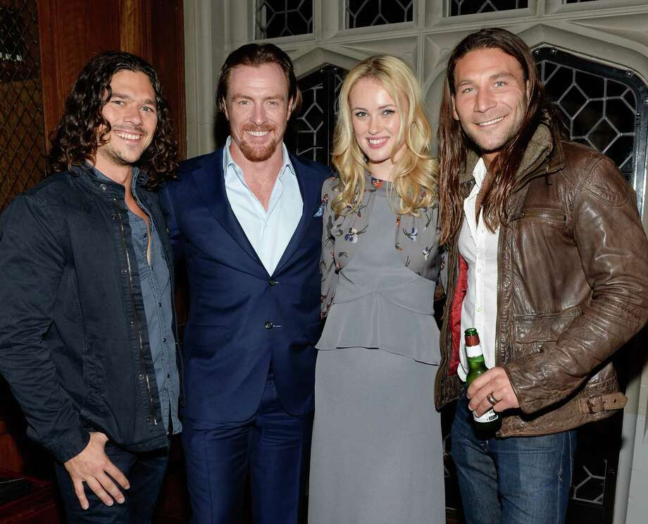 "IMAGE DISTRIBUTED FOR STARZ - Cast members Luke Arnold, left, Toby Stephens, Hannah New and Zach McGowan, right, attend a private dinner for the new Starz original series ""Black Sails"" at the Explorers Club on Tuesday, Jan. 14, 2014 in New York. (Photo by Evan Agostini/Invision for Starz/AP Images) ORG XMIT: INVL Photo: Evan Agostini / Invision"
