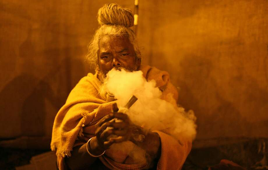 Another man who doesn't think marijuana is more dangerous than alcohol: A sadhu, or Hindu holy man, exhales a lungful of cannabis smoke in Allahabad, India. Photo: Rajesh Kumar Singh, Associated Press