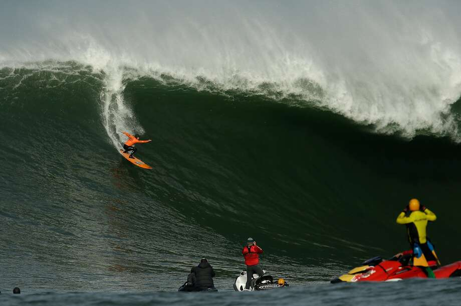 Tyler Fox rides a wave during the second heat of round one of Mavericks Invitational on January 24, 2014 in Half Moon Bay, California. Photo: Ezra Shaw, Getty Images