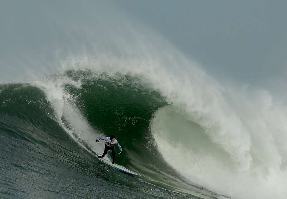 Grant Washburn rides a wave during the second heat of round one of Mavericks Invitational on January 24, 2014 in Half Moon Bay, California. Photo: Ezra Shaw, Getty Images