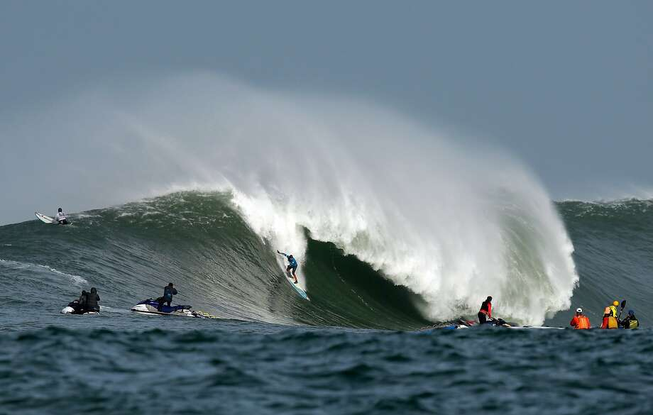 Peter Mel rides a wave during the second heat of round one of Mavericks Invitational on January 24, 2014 in Half Moon Bay, California. Photo: Ezra Shaw, Getty Images