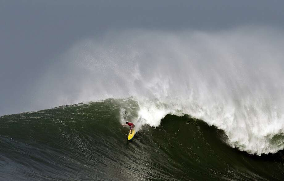 Colin Dwyer rides a wave during the second heat of round one of Mavericks Invitational on January 24, 2014 in Half Moon Bay, California. Photo: Ezra Shaw, Getty Images