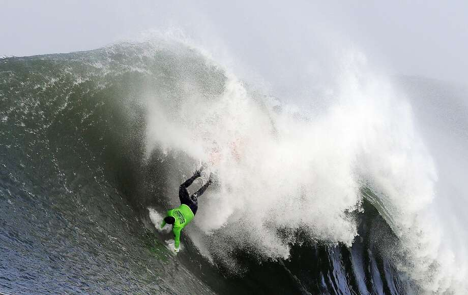 Ben Wilkinson goes tumbling into a wave during the third heat of the first round of the Mavericks Invitational big wave surf contest Friday, Jan. 24, 2014, in Half Moon Bay, Calif. Photo: Eric Risberg, Associated Press