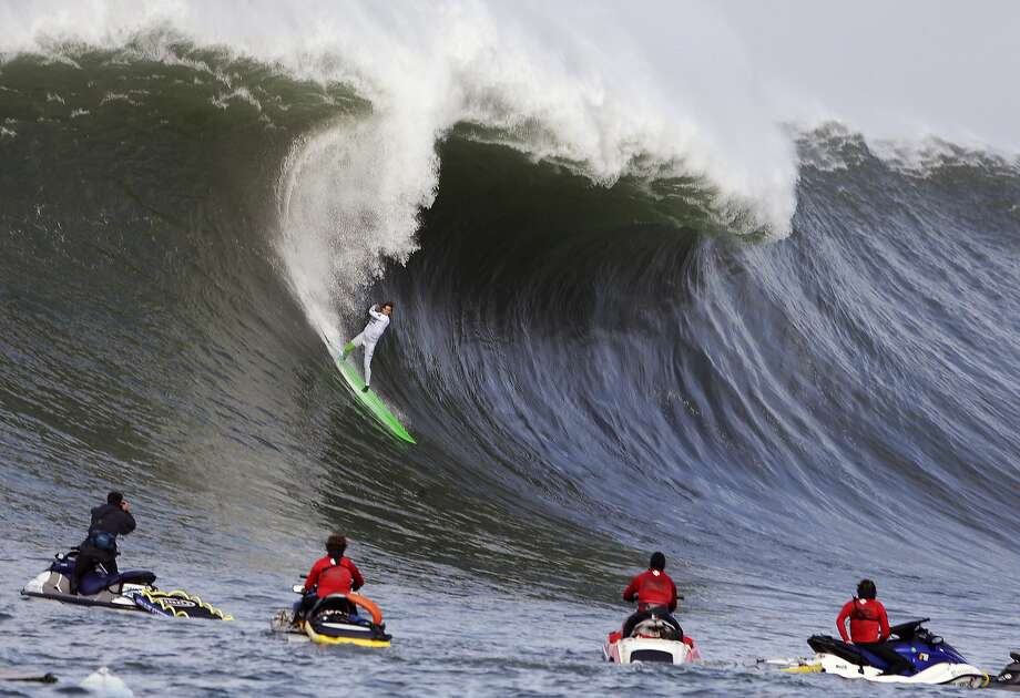 Nic Lamb rides a wave during the third heat of the first round of the Mavericks Invitational big wave surf contest Friday, Jan. 24, 2014, in Half Moon Bay, Calif. Photo: Eric Risberg, Associated Press