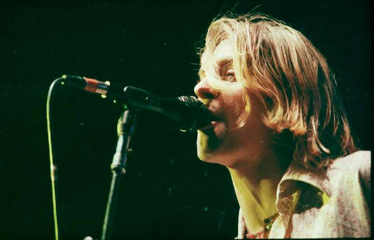 Kurt Cobain performs at Seattle Center Arena as part of Nirvana's In Utero tour Jan. 7, 1994. Kurt Smith/Copyright MOHAI, Seattle Post-Intelligencer Collection, 2000.107_negsBox4-19940107-roll 1-frame-5