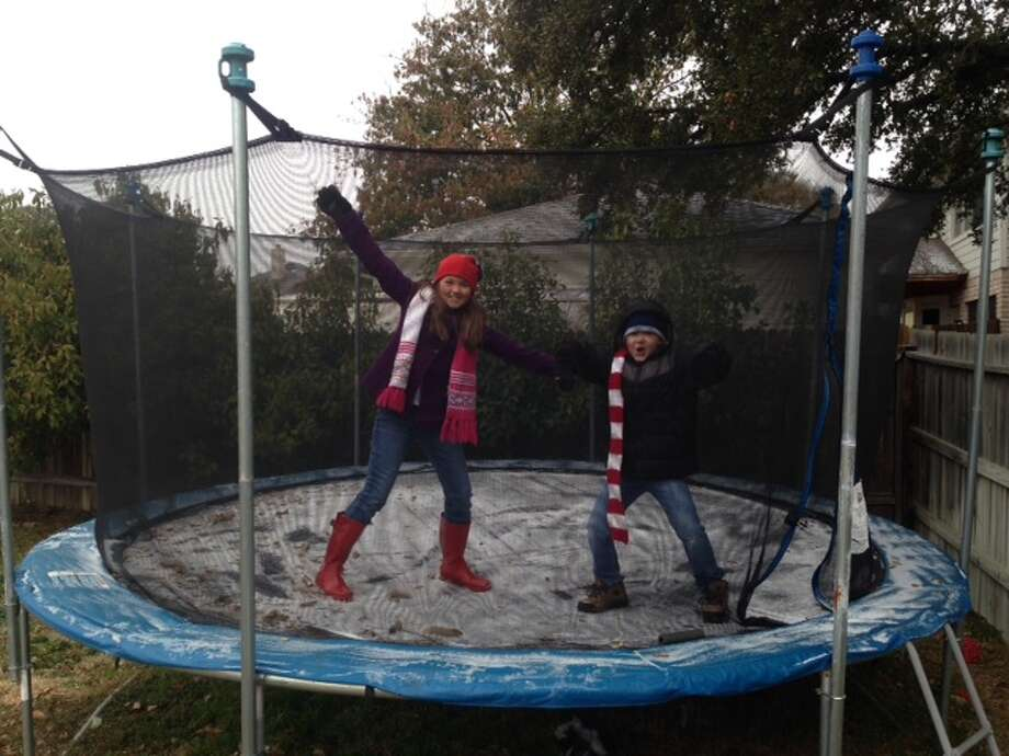 """Ice skating"" on iced-over trampoline Friday morning in Stone Oak back yard. Photo: Abe Levy/San Antonio Express-News"