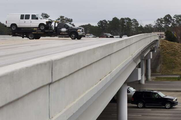 A van that was involved in an accident due to icy conditions is towed off the Louetta bridge at I-45 North Friday, Jan. 24, 2014, in Spring. ( Brett Coomer / Houston Chronicle ) Photo: Brett Coomer, Houston Chronicle
