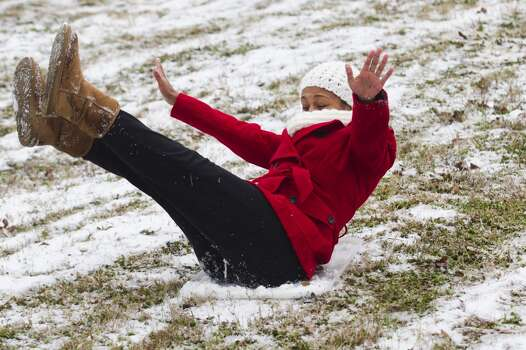 Sam Houston State University student Paris Mayfield, of Houston, slides down a snow-covered hill following an overnight snowfall Friday, Jan. 24, 2014, in Huntsville. Classes at SHSU were cancelled Friday. ( Brett Coomer / Houston Chronicle ) Photo: Brett Coomer, Houston Chronicle