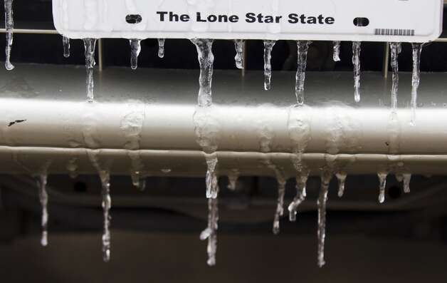 Icicles hang from a car bumper following an overnight snowfall Friday, Jan. 24, 2014, in Huntsville. Classes at SHSU were cancelled Friday. ( Brett Coomer / Houston Chronicle ) Photo: Brett Coomer, Houston Chronicle