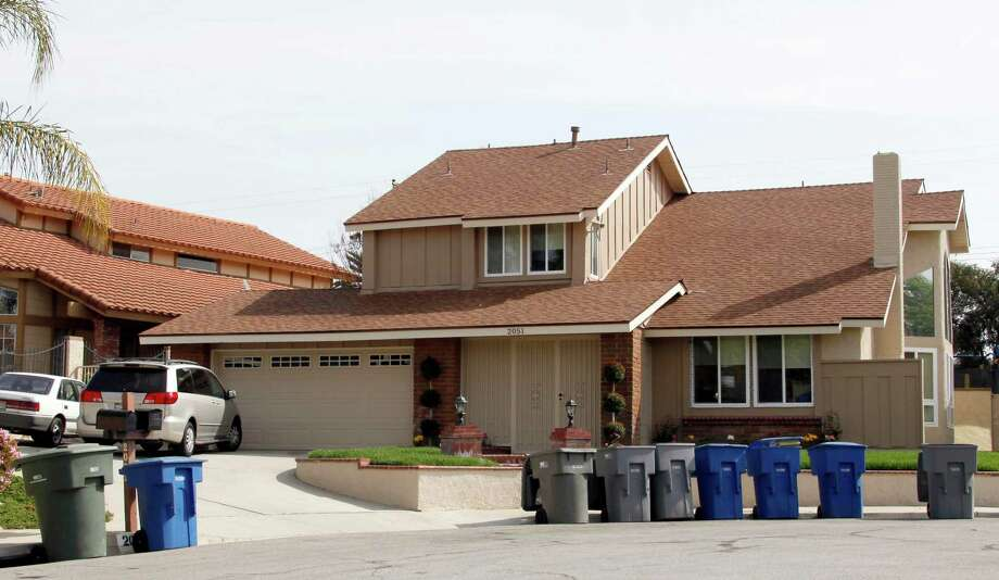 """6) ON THE MOVE: The house Suleman bought after the birth of her octuplets was put on the auction block in 2012 after she defaulted on a loan. She tried to save it by filing for bankruptcy but a judge dismissed the case when she never completed the paperwork. She has gone on to live in rental houses.PHOTO:  Nadya Suleman's home is shown in La Habra, Calif., on March 24, 2010. Suleman, also known as """"Octomom"""" for giving birth to octuplets has defaulted on a $450,000 balloon payment on her house and is facing foreclosure within days if payment is not made. Photo: Nick Ut, Associated Press / AP2010"""