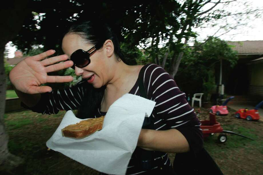 "Despite all the attention she's generated, Suleman has kept her octuplets largely out of the public eye and shared little about them. As they turn 5, here are eight things to know about ""Octomom:""PHOTO: Nadya Suleman, the mother of octuplets raises her hand to avoid paparazzi outside her home in Whittier, Calif., on March 11, 2009. Photo: Nick Ut, Associated Press / AP2009"