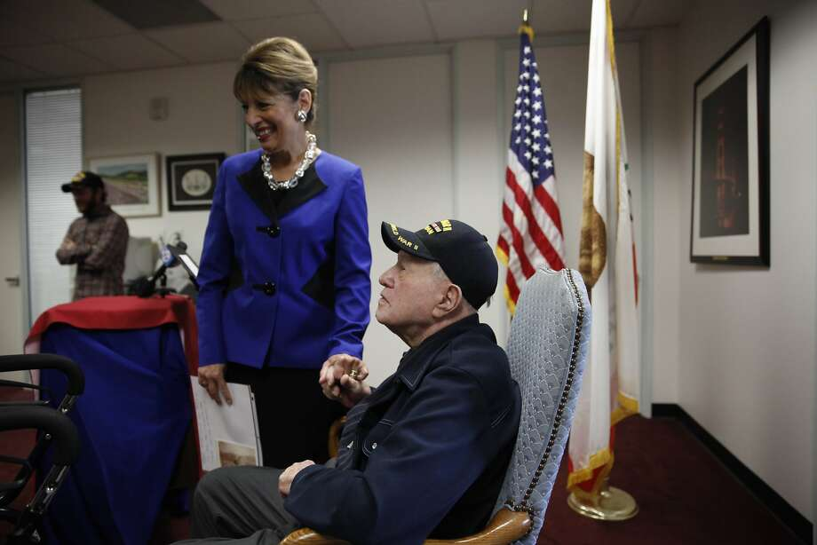 Rep. Jackie Speier clasps World War II veteran John Brenan's hand before a news conference declaring victory in Brenan's long-running fight for compensation from the Department of Veterans Affairs. Photo: Lea Suzuki, The Chronicle