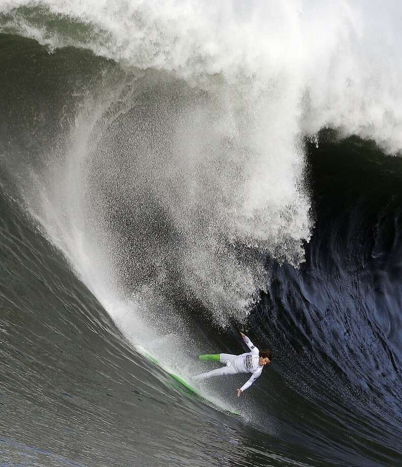 Nic Lamb begins to fall off his board during the third heat of the first round of the Mavericks Invitational big wave surf contest Friday, Jan. 24, 2014, in Half Moon Bay, Calif. Photo: Eric Risberg, Associated Press