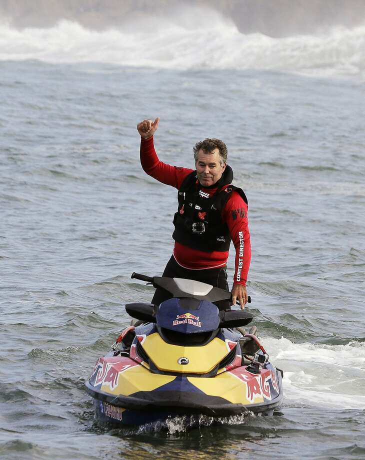 Contest director and founder Jeff Clark gives a thumbs up at the start of the second heat of the first round of the Mavericks Invitational big wave surf contest Friday, Jan. 24, 2014, in Half Moon Bay, Calif. Photo: Eric Risberg, Associated Press