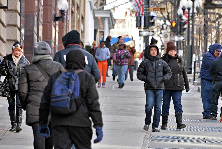 Pedestrians hurry along the sidewalk on State Street as temperatures struggle to reach double digits  Jan. 24, 2014, in Albany,NY.  (John Carl D'Annibale / Times Union) Photo: John Carl D'Annibale