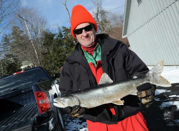 Ice fisherman Richard Nolan of Ballston Spa holds a Lake Trout he just caught on Lake George Friday, Jan. 24, 2014 in Bolton Landing, N.Y. (Lori Van Buren / Times Union) Photo: Lori Van Buren