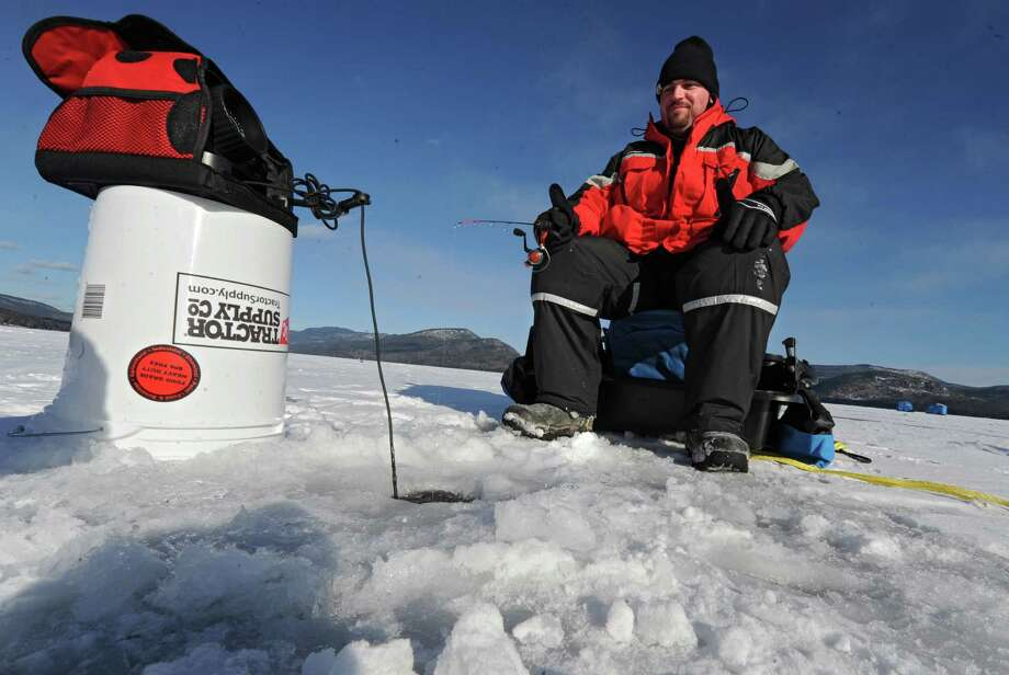 Bill Remillard of Schenectady ice fishes on Lake George Friday, Jan. 24, 2014 in Bolton Landing, N.Y. (Lori Van Buren / Times Union) Photo: Lori Van Buren