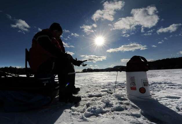 Bill Remillard of Schenectady ice fishes on Lake George Friday, Jan. 24, 2014 in Bolton Landing, N.Y. (Lori Van Buren / Times Union) Photo: Lori Van Buren