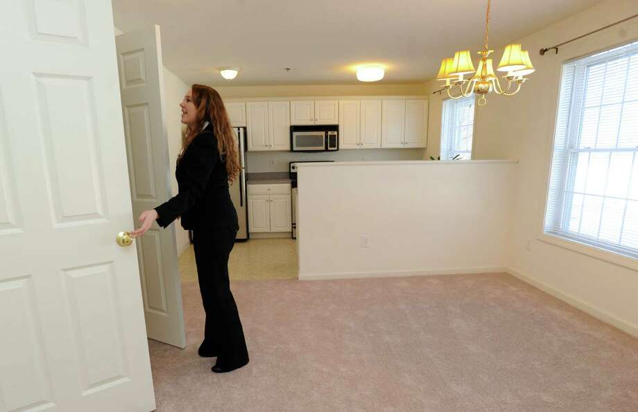 "Jessica Ganser, 31, executive assistant to Paul Scalzo, talks about a one-bedroom, one-level apartment for rent at 20 Orchard Place in Brookfield, Conn., Friday, January 24, 2014. This particular apartment is designated  ""affordable housing."" Photo: Carol Kaliff / The News-Times"