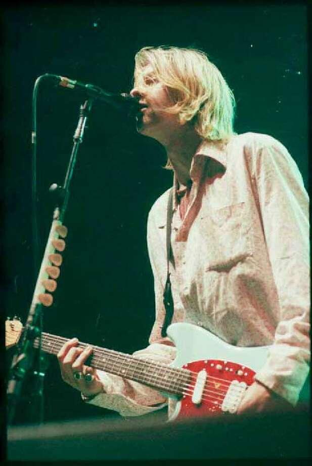 Kurt Cobain performs at Seattle Center Arena as part of Nirvana's In Utero tour Jan. 7, 1994. Kurt Smith/Copyright MOHAI, Seattle Post-Intelligencer Collection, 2000.107_negsBox4-19940107-roll 1-frame-1 Photo: Burton, Lynsi, Kurt Smith/Copyright MOHAI, Seattle Post-Intelligencer Collection, 2000.107_negsBox4-19940107