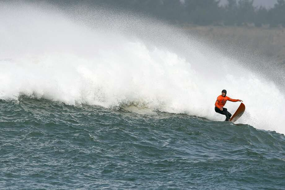 Tyler Fox rides out of a wave during Semi finals round 1 of the 2014 Maverick's Invitational surf contest held in Half Moon Bay, CA, Friday, January 24, 2014. Photo: Michael Short, The Chronicle