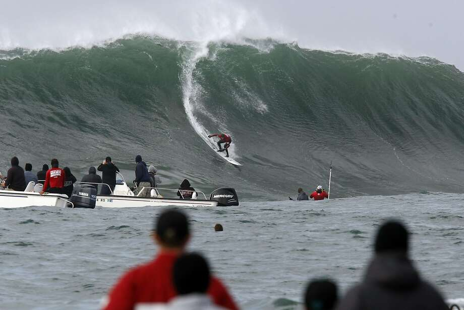 Rusty Long drops into a wave during Semi final round 2 of the 2014 Maverick's Invitational surf contest held in Half Moon Bay, CA, Friday, January 24, 2014. Photo: Michael Short, The Chronicle